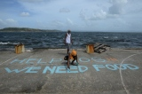 "GPS | TACLOBAN | Filipino writes message on basketball court: ""Help SOS!!! We Need Food"""